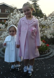 Photo received from a customer in England around 1998! Both girls dressed by Connie's Kids for Easter!